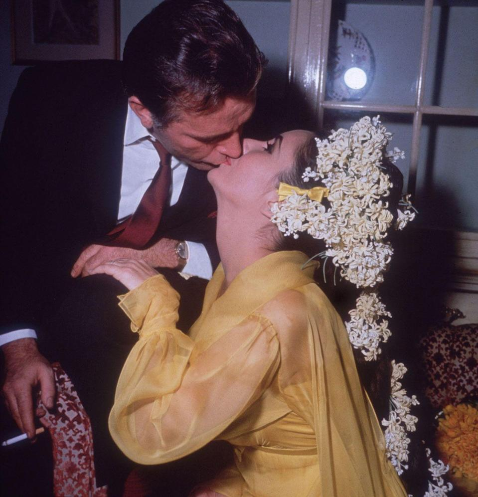 "<p><a href=""http://www.womansday.com/life/entertainment/g2243/elizabeth-taylor-and-richard-burton-love-story/"" rel=""nofollow noopener"" target=""_blank"" data-ylk=""slk:For her first wedding to Richard Burton"" class=""link rapid-noclick-resp"">For her first wedding to Richard Burton</a> Elizabeth Taylor wore a bold yellow dress and extravagant floral headdress. The couple divorced in 1974, but married again in1975.</p>"