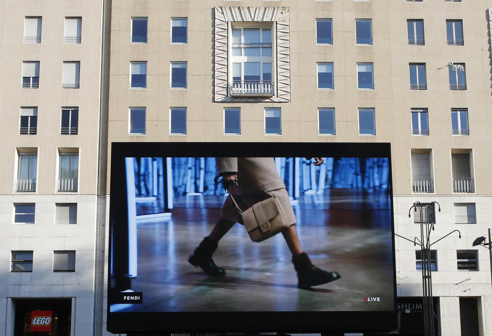 A giant screen streams a Fendi fashion live show during the Milan's fashion week in Milan, Italy, Friday, Jan. 15, 2021. (AP Photo/Antonio Calanni)