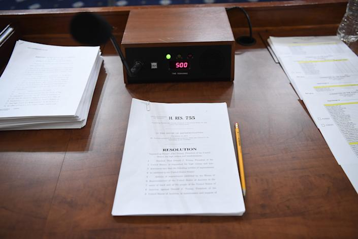 A printed copy of H.Res. 755, Articles of Impeachment Against President Donald J. Trump is seen on a table as the House Judiciary Committee continues debate to markup the Articles of Impeachment Against President Donald J. Trump in Washington, DC on Dec. 12, 2019.