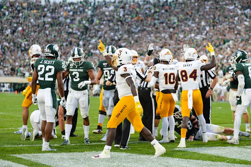 EAST LANSING, MI - SEPTEMBER 14: Arizona State running back Eno Benjamin (3) and his teammates celebrate his touchdown during a college football game between the Michigan State Spartans and Arizona State Sun Devils on September 14, 2019 at Spartan Stadium in East Lansing, MI. (Photo by Adam Ruff/Icon Sportswire via Getty Images)