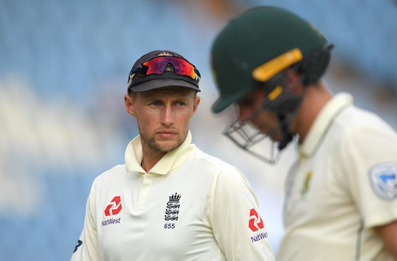 CENTURION, SOUTH AFRICA - DECEMBER 27: England captain Joe Root looks on as Anrich Nortje leaves the field after Day Two of the First Test match between England and South Africa at SuperSport Park on December 27, 2019 in Pretoria, South Africa. (Photo by Stu Forster/Getty Images)