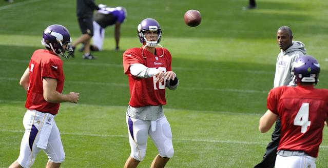 Viking quarterbacks Matt Cassel, left, Christian Ponder, center, and McLeod Bethel-Thompson in action during their football practice at the Grove Hotel in Watford, England, Thursday Sept. 26, 2013. The Pittsburgh Steelers are to play the Minnesota Vikings in the NFL International Series at Wembley Stadium in London on Sunday, Sept 29. (AP Photo/Sean Ryan, NFL)