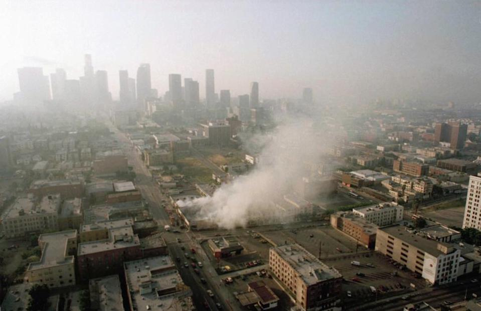 Smoke rises from a shopping center burned by rioters in Los Angeles on 30 April 1992.