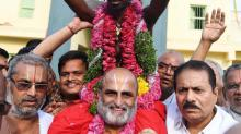 Hindu priest carries 'untouchable' into temple to show 'everyone is equal in the eyes of God'