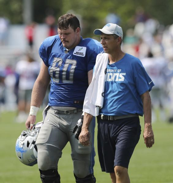 Detroit Lions center Graham Glasgow walks off the field at the team's football training camp, Tuesday, Aug. 14, 2018, in Allen Park, Mich. (AP Photo/Carlos Osorio)