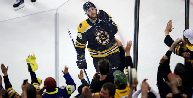 Boston Bruins right wing David Pastrnak celebrates with fans after his goal off Toronto Maple Leafs goaltender Frederik Andersen during the third period of Game 7 of an NHL hockey first-round playoff series in Boston, Wednesday, April 25, 2018. (AP Photo/Charles Krupa)