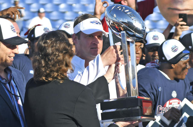 Florida Atlantic head coach Lane Kiffin prepares to hand the Conference USA trophy to his players after defeating North Texas. (Jim Rassol/South Florida Sun-Sentinel via AP)