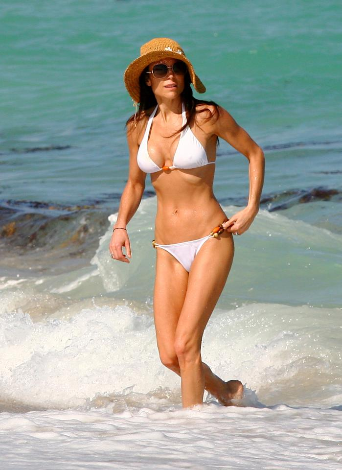 "<b>Bethenny Frankel<br></b><br>""Skinny Girl"" mogul and ""Real Housewives"" alum Bethenny Frankel really knows how to sell a product, flaunting her svelte, toned figure in a simple white bikini and a wide-brimmed hat. The 41-year-old reality star is giving much younger girls a run for their gym memberships!"