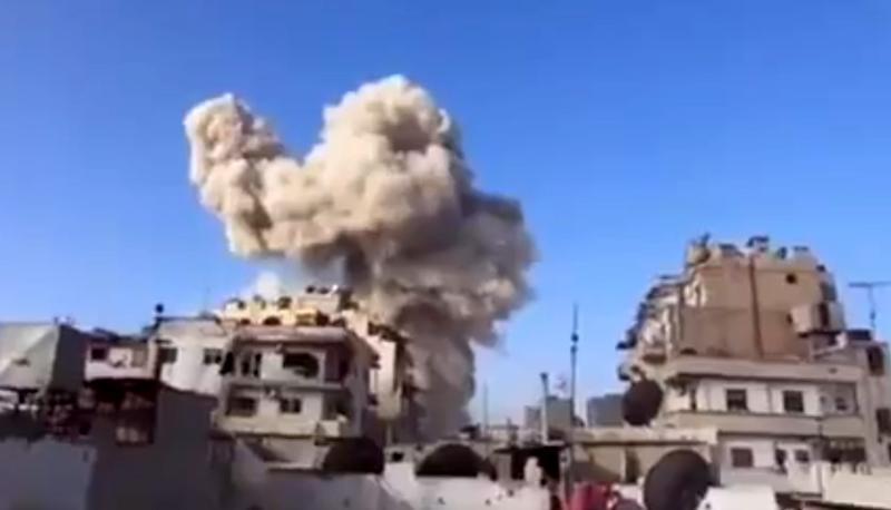 In this image taken from video obtained from the Ugarit News, which has been authenticated based on its contents and other AP reporting, smoke leaps the air from a building after a warplane attack in Homs, Syria, on Wednesday, Nov. 28, 2012. (AP Photo/Ugarit News via AP video)