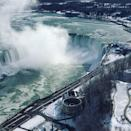 <p>Water flows over the Niagara Falls viewed from the Canadian side, Ontario, Canada January 2, 2018 in this picture obtained from social media. Courtesy THOMAS BVRD/REUTERS </p>