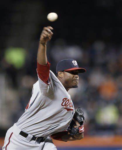Washington Nationals starting pitcher Edwin Jackson delivers in the second inning against the New York Mets during a baseball game in New York, Monday, April 9, 2012. (AP Photo/Kathy Willens)