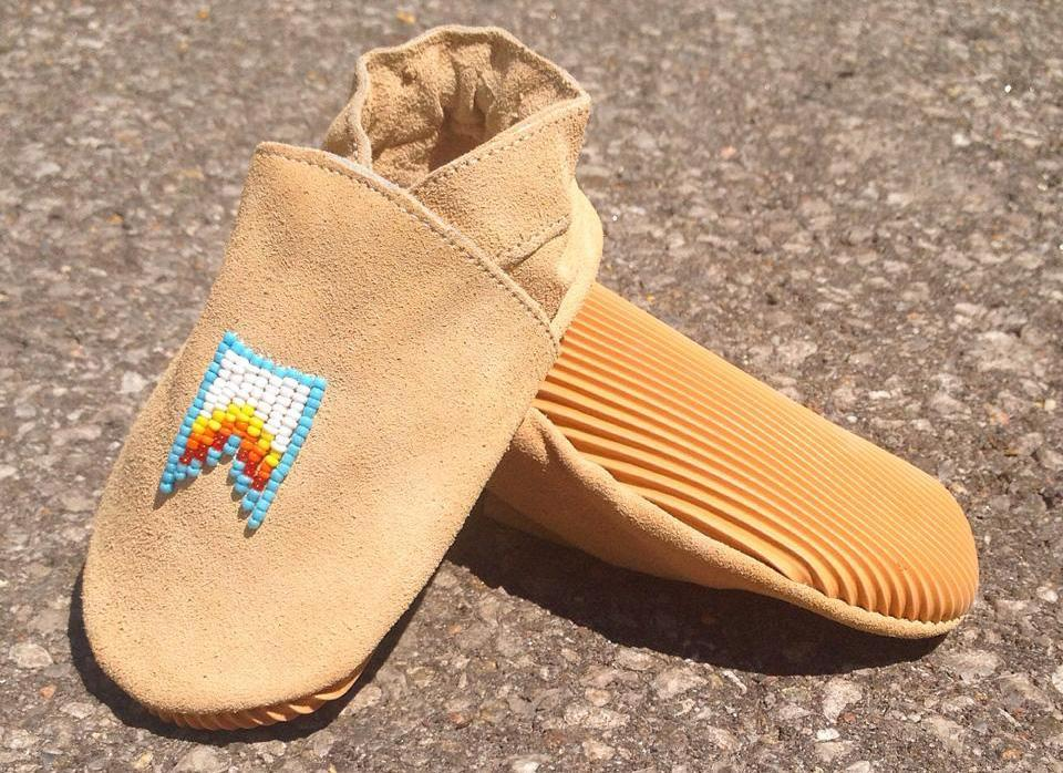 """A pair of baby moccasins made by Quemeez. The company was started by <span class=""""s1"""">Sunshine Tenasco and was eventually invested in by 'Dragon's Den' investors.</span> (Quemeez/Facebook)"""