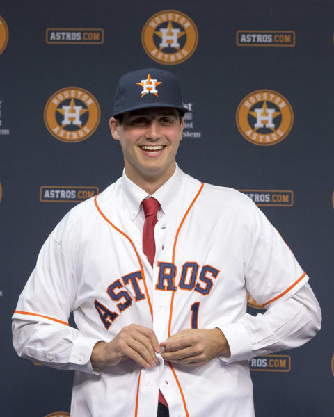 Newly-signed Houston Astros pitcher Mark Appel buttons his jersey during a news conference Wednesday, June 19, 2013 in Houston, to announce his signing. Appel was selected with the No. 1 overall pick in baseball's first-year player draft. (AP Photo/David J. Phillip)