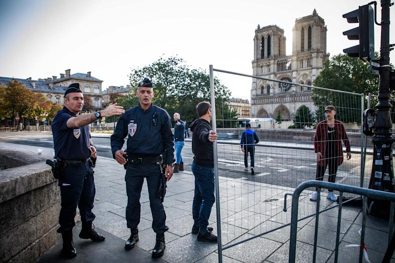 Police officers secure a perimeter around the cathedral (EPA)