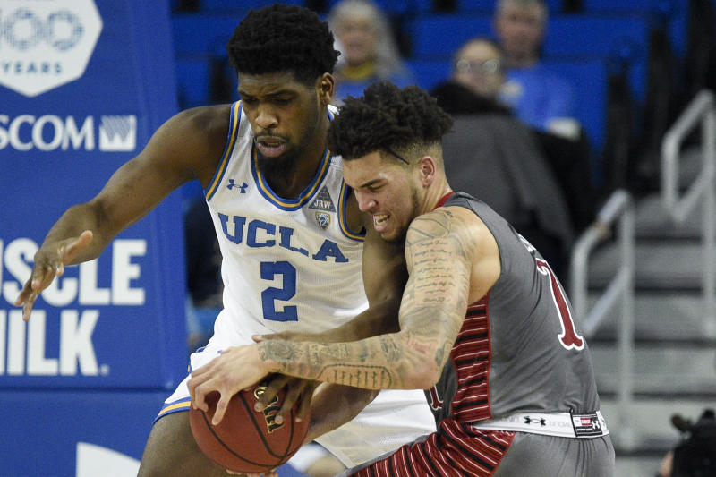 UCLA forward Cody Riley, left, steals the ball from Utah forward Timmy Allen during the first half of an NCAA college basketball game in Los Angeles, Sunday, Feb. 2, 2020. (AP Photo/Kelvin Kuo)