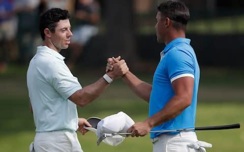 <span>McIlroy and Brooks Koepka pictured together at the World Golf Championships in July</span> <span>Credit: AP </span>