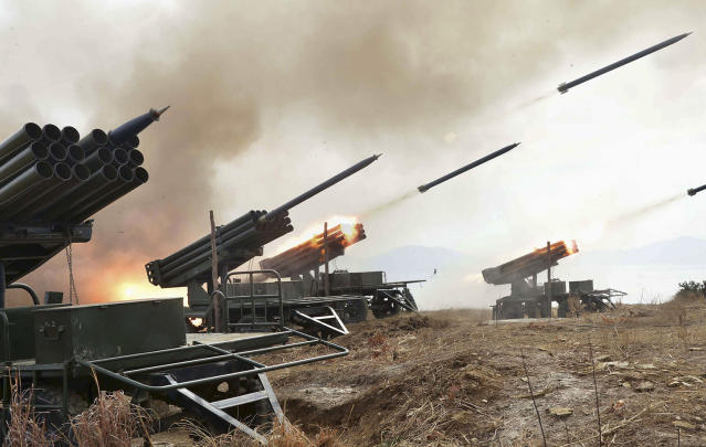 <p>A view of artillery fire and landing exercises guided by North Korean leader Kim Jong Un in this undated photo. (KCNA/Reuters) </p>