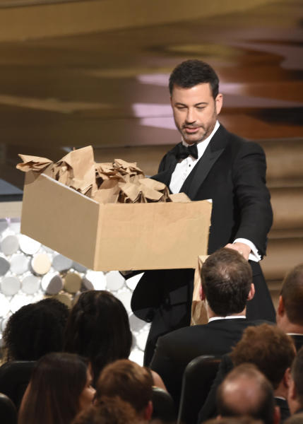 Host Jimmy Kimmel distributes sandwiches at the 68th Primetime Emmy Awards on Sunday, Sept. 18, 2016, at the Microsoft Theater in Los Angeles. (Photo by Chris Pizzello/Invision/AP)