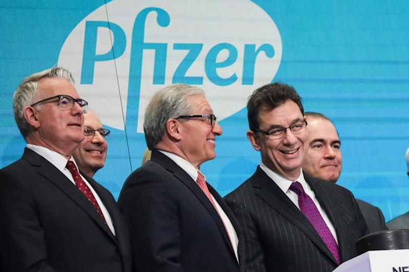 NEW YORK, NY - JANUARY 17: Albert Bourla (R), chief executive officer of Pfizer pharmaceutical company, waits to ring the closing bell at the New York Stock Exchange (NYSE) on Thursday afternoon, January 17, 2019 in New York City. The Dow Jones Industrial Average was up over 150 points at the close on Thursday, after news reports that Treasury Secretary Steven Mnuchin is floating a proposal to lift some U.S. tariffs on Chinese goods in an effort to push trade talks forward between the U.S. and China. (Photo by Drew Angerer/Getty Images)