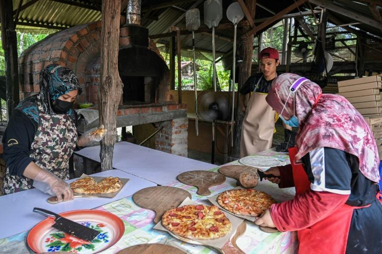 A Malaysia family opened a pizzeria in their backyard to combat their economic woes during the pandemic