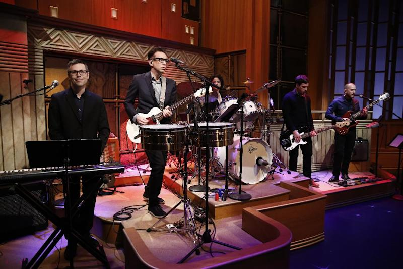 "In this photo provided by NBC, Fred Armisen, second left, and the 8G Band perform on the premiere of ""Late Night with Seth Meyers"" on Monday, Feb. 24, 2014, in New York. (AP Photo/NBC, Peter Kramer)"
