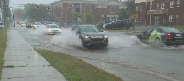 The rain flooded streets in downtown Charlottetown. (Brian Higgins/CBC - image credit)
