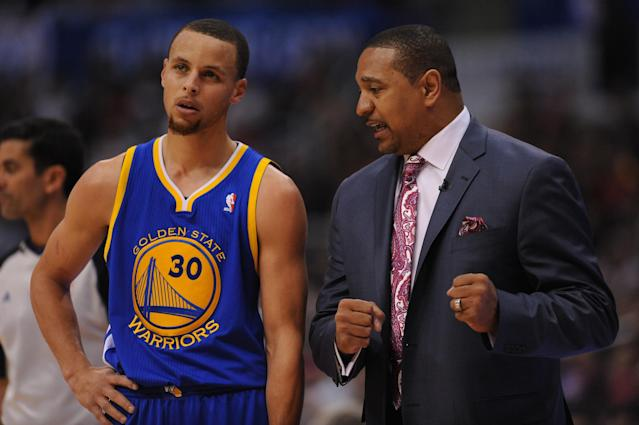 LOS ANGELES, CA - APRIL 29: Mark Jackson of the Golden State Warriors directs Stephen Curry #30 during Game Five of the Western Conference Quarterfinals against the Los Angeles Clippers at Staples Center on April 29, 2014 in Los Angeles, California. (Photo by Noah Graham/NBAE via Getty Images)