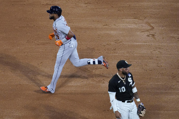 Detroit Tigers' Willi Castro runs past Chicago White Sox third baseman Yoan Moncada after Castro hit a home run during the fifth inning of a baseball game in Chicago, Thursday, June 3, 2021. (AP Photo/Nam Y. Huh)
