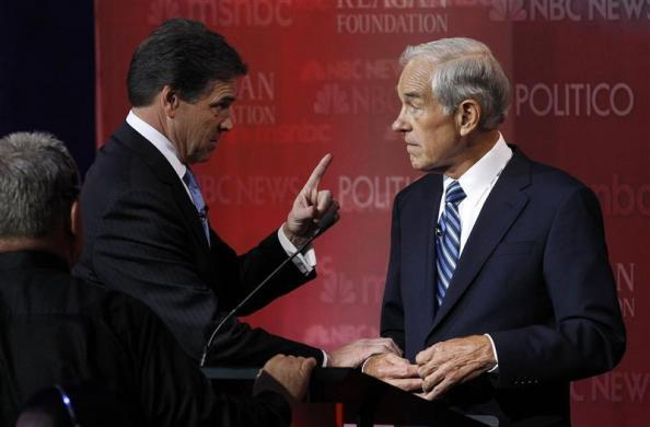Rick Perry talks during a break with Ron Paul on stage at the Reagan Centennial GOP presidential primary debate at the Ronald Reagan Presidential Library in Simi Valley, California September 7, 2011. (REUTERS/Mario Anzuoni)