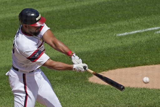 Chicago White Sox's Jose Abreu hits a single against the Kansas City Royals during the third inning of a baseball game in Chicago, Sunday, Aug. 30, 2020. (AP Photo/Nam Y. Huh)