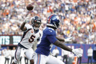 Denver Broncos quarterback Teddy Bridgewater (5) throws a pass to Tim Patrick (81) for a touchdown during the first half of an NFL football game against the New York Giants Sunday, Sept. 12, 2021, in East Rutherford, N.J. (AP Photo/Adam Hunger)