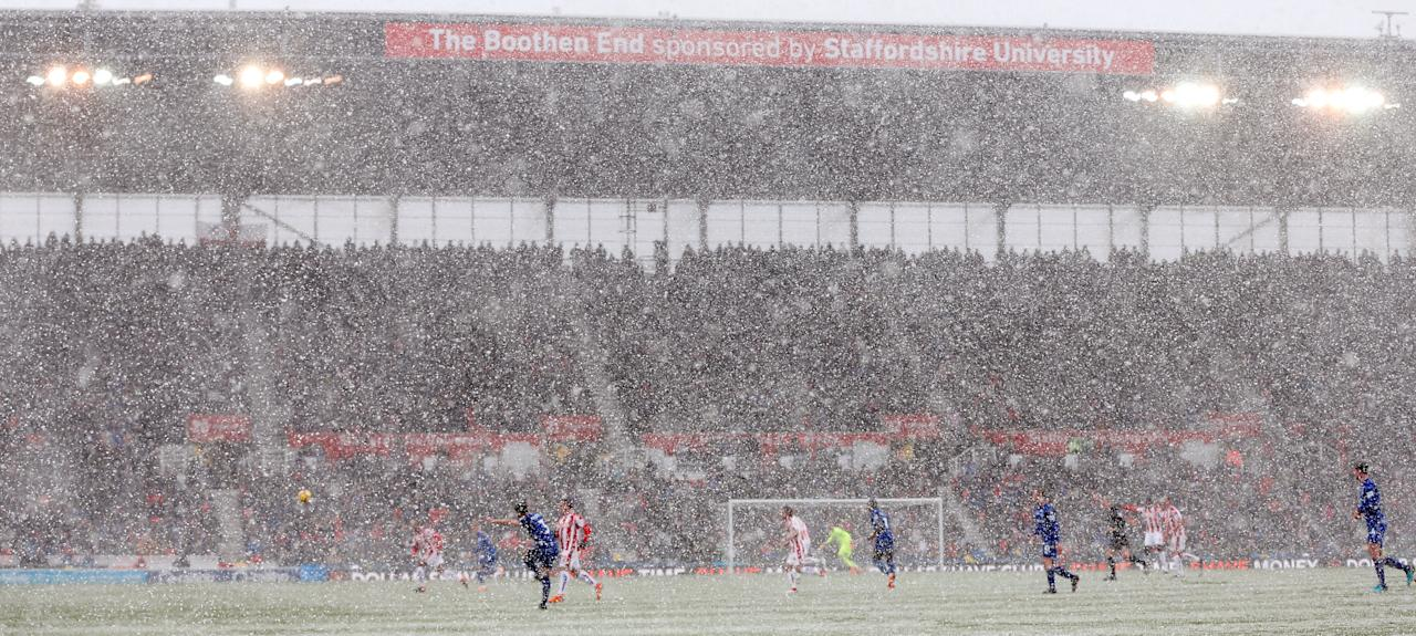 """Soccer Football - Premier League - Stoke City vs Everton - bet365 Stadium, Stoke-on-Trent, Britain - March 17, 2018   General view of match action as it snows          Action Images via Reuters/Ed Sykes    EDITORIAL USE ONLY. No use with unauthorized audio, video, data, fixture lists, club/league logos or """"live"""" services. Online in-match use limited to 75 images, no video emulation. No use in betting, games or single club/league/player publications.  Please contact your account representative for further details.     TPX IMAGES OF THE DAY"""