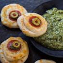 "<p>These bite-size pizzas are paired with a rich pesto dipping sauce, and wow, are they good. </p> <p><strong>Get the recipe:</strong> <a href=""https://spicysouthernkitchen.com/monster-eyeball-pizzas/"" class=""link rapid-noclick-resp"" rel=""nofollow noopener"" target=""_blank"" data-ylk=""slk:monster eyeball pizzas"">monster eyeball pizzas</a></p>"