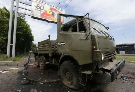 A wrecked Kamaz truck is seen near the Donetsk airport May 27, 2014. REUTERS/Yannis Behrakis