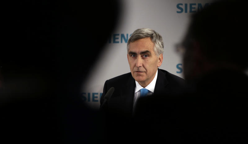 """FILE - In this Jan. 23, 2013 file picture Peter Loescher, CEO of German industrial conglomerate Siemens, listens questions of journalists during a news conference prior to the annual shareholder meeting in Munich, southern Germany. German engineering giant Siemens AG says it will be replacing its chief executive, who has drawn the ire of shareholders by failing to meet profit targets. Siemens said in a statement late Saturday July 27, 2013 that its board will meet Wednesday to """"decide on the early departure of the president and CEO"""" Peter Loescher. (AP Photo/Matthias Schrader,File)"""
