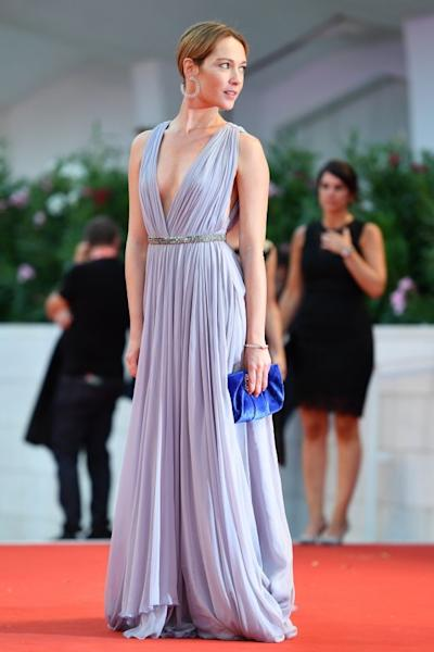 Cristiana Capotondi was an apparition in a long lavender pleated Etro dress, accented by a thin silver-colored belt. Venice, September 2, 2019