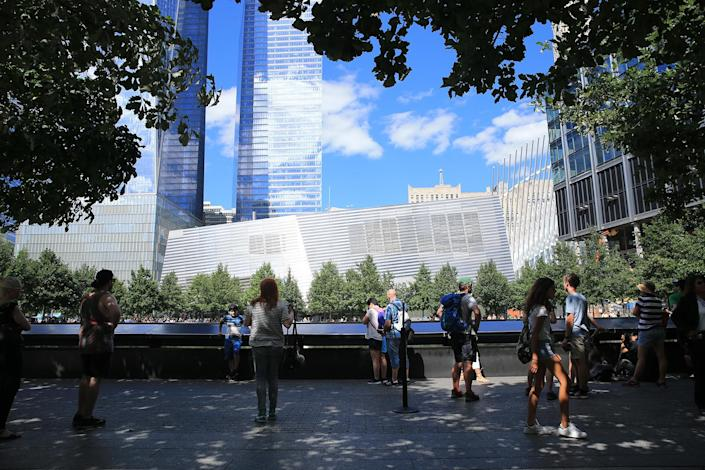 <p>Visitors gather to pay tribute to the victims of the Sept. 11 attacks near one of two reflecting pools at the National September 11 Memorial & Museum on Aug. 22, 2016. (Gordon Donovan/Yahoo News) </p>