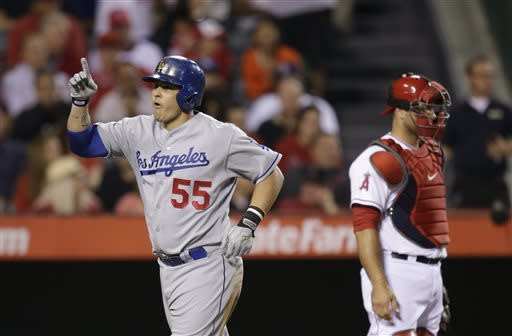 Los Angeles Dodgers' Ramon Hernandez, left, reacts after hitting a home run against the Los Angeles Angels during the fifth inning of an interleague baseball game in Anaheim, Calif., Thursday, May 30, 2013. At right is Angels catcher Chris Iannetta. (AP Photo/Jae C. Hong)