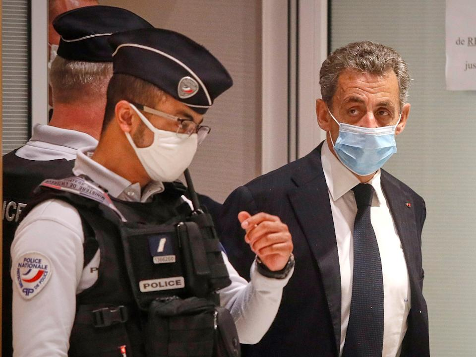 Former French President Nicolas Sarkozy leaves court after the opening of his trial for corruption and influence pedalling on 23 November, 2020 in Paris, France (Getty Images)