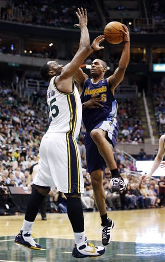 Denver Nuggets guard Arron Afflalo (6) takes a shot over Utah Jazz center Al Jefferson (25) during the first half of an NBA basketball game, Friday, March 23, 2012, in Salt Lake City. (AP Photo/Jim Urquhart)