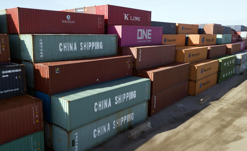 FILE - In this May 10, 2019, file photo China Shipping Company and other containers are stacked at the Virginia International's terminal in Portsmouth, Va. A coalition of 161 manufacturers, farmers, retailers, natural gas and oil companies as well as other business groups, has signed a letter asking President Donald Trump to postpone all tariff rate increases on Chinese goods slated to take effect this year. The letter, dated Wednesday, Aug. 28, and organized by Americans for Free Trade Coalition, comes as tariff increases are set to take effect starting this Sunday, followed by further increases Oct. 1 and Dec. 15. (AP Photo/Steve Helber, File)