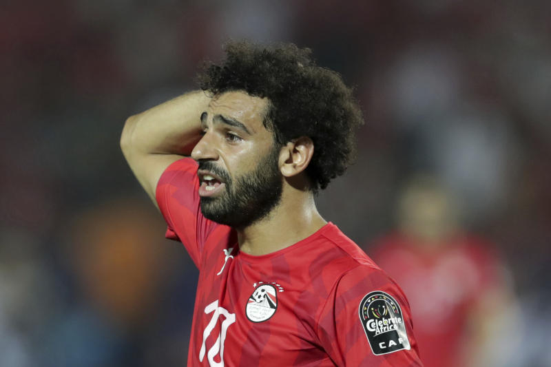 Egypt's Mohamed Salah walks in dejection end of the African Cup of Nations round of 16 soccer match between Egypt and South Africa in Cairo International stadium in Cairo, Egypt, Saturday, July 6, 2019. South Africa won 1-0. (AP Photo/Hassan Ammar)