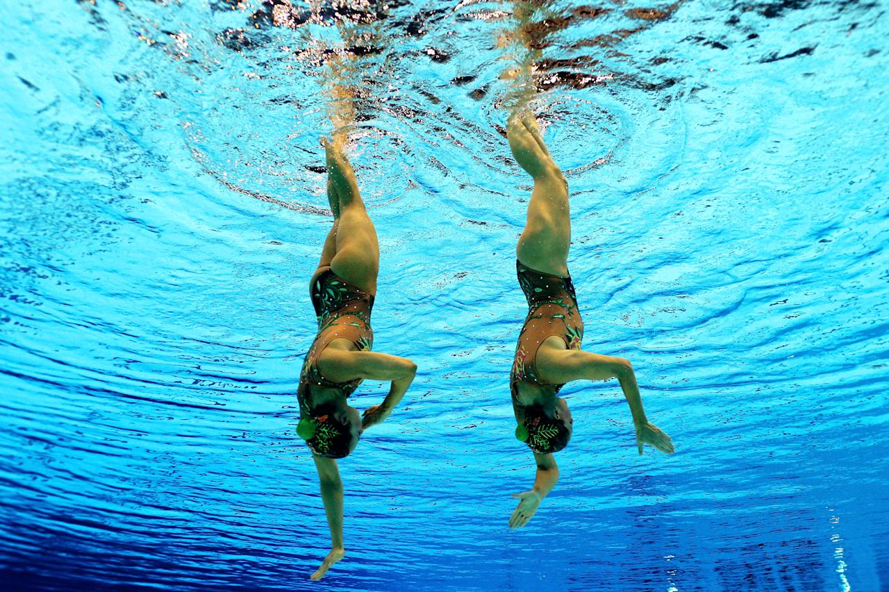 Eloise Amberger and Sarah Bombell of Australia compete in the Women's Duets Synchronised Swimming Free Routine Preliminary on Day 10 of the London 2012 Olympic Games at the Aquatics Centre on August 6, 2012 in London, England.  (Photo by Clive Rose/Getty Images)