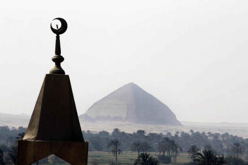 A minaret is seen in front of the ancient Dahshour pyramid at Dahshour village, about 40 kilometers (25 miles) south of Cairo, Thursday, Aug. 2, 2012, a day after a sectarian violence erupted the village following the death of a Muslim man, prompting most the local Christians to flee, church and security officials said. (AP Photo/Amr Nabil)