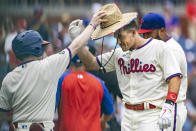 Philadelphia Phillies' J.T. Realmuto, right, is congratulated after hitting the winning home run in the 10th inning of a baseball game against the Miami Marlins, Sunday, July 18, 2021, in Philadelphia. It was a continuation of the previous day's game which was suspended due to rain. (AP Photo/Laurence Kesterson)