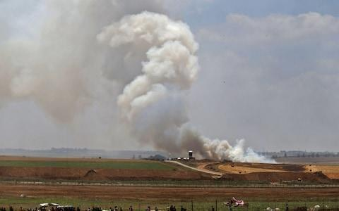 <span>Smoke billows from the Israeli side after a kite loaded with a molotov cocktail crossed the border between Israel and the Gaza strip</span> <span>Credit: MOHAMMED ABED/AFP </span>