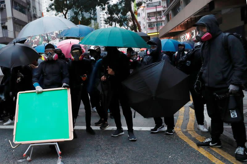 Anti-government protesters react as they standoff during a demonstration on the New Year's Day to call for better governance and democratic reforms in Hong Kong