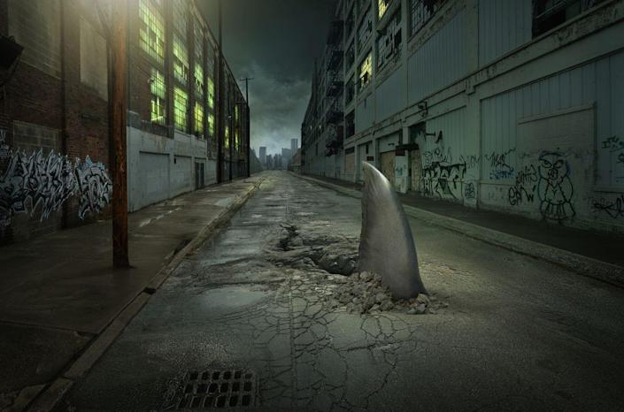 """<p>Leave it to <em>Sharknado</em>, because that's the only place you're really going to see a shark cutting right through the asphalt. When Hurricane Laura tore through Texas and Louisiana in 2020, a photo of a shark swimming down the freeway went viral again. But the photo is nothing more than a hoax that has been circulating since 2011, which is nothing more than a <a href=""""https://www.popularmechanics.com/technology/security/a28691128/deepfake-technology/"""" rel=""""nofollow noopener"""" target=""""_blank"""" data-ylk=""""slk:doctored image."""" class=""""link rapid-noclick-resp"""">doctored image.</a><br></p>"""