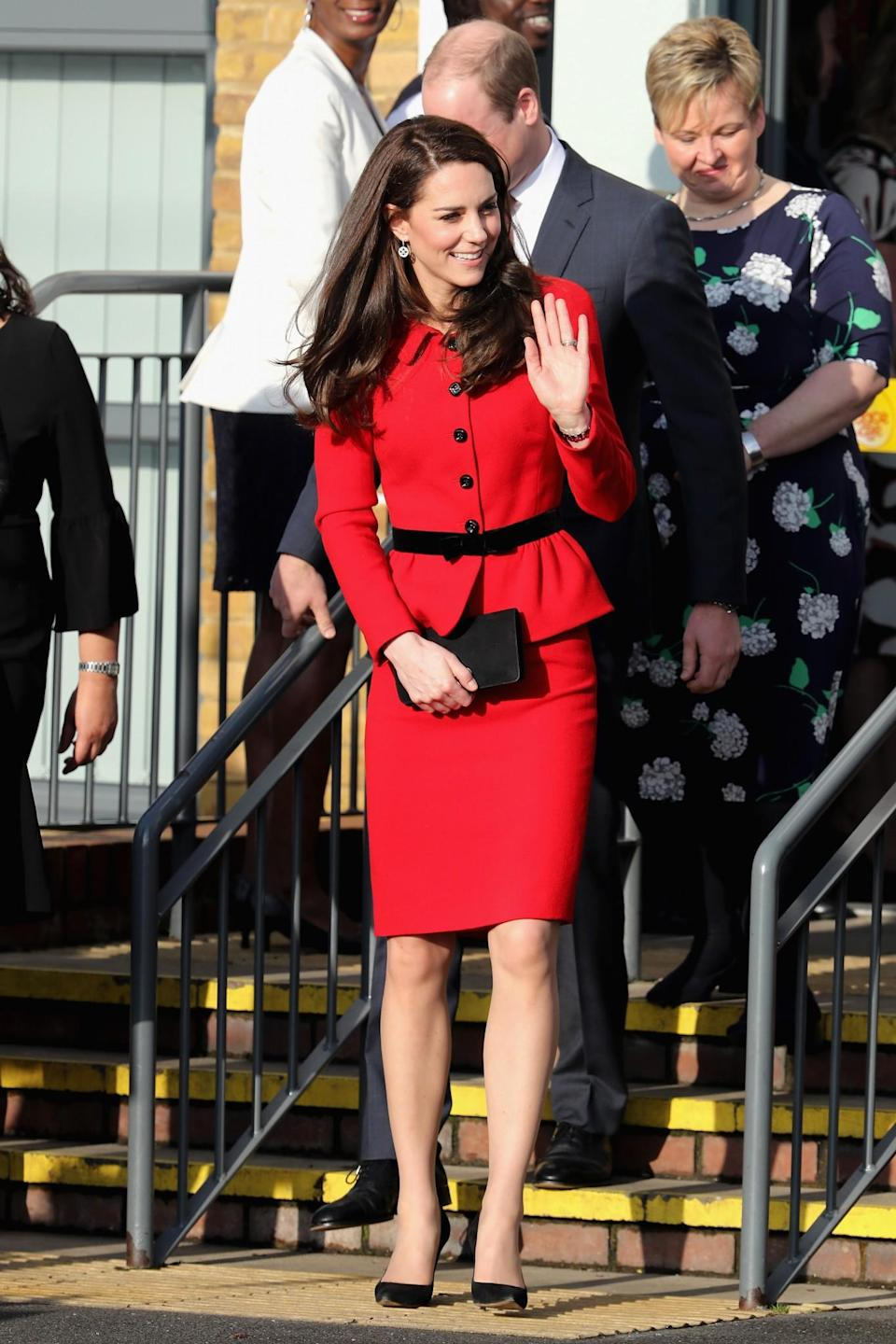 <p>Kate chose one of her favourite suits for a London school visit. Donning a bold red skirt suit by Italian designer Luisa Spagnoli, the Duchess attended a school assembly as part of her mental health initiative. Black suede pumps and a matching clutch proved to be ther perfect simple accessories.<br><i>[Photo: PA]</i> </p>