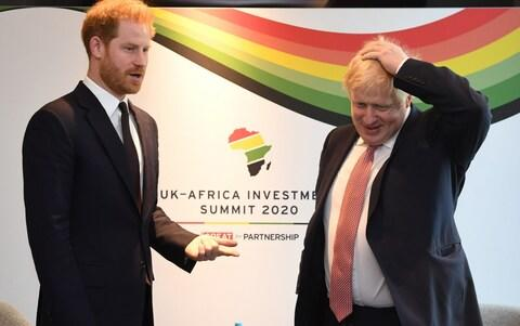 Prince Harry, Duke of Sussex, speaks with British Prime Minister Boris Johnson as they attend the UK-Africa Investment Summit - Credit: Getty